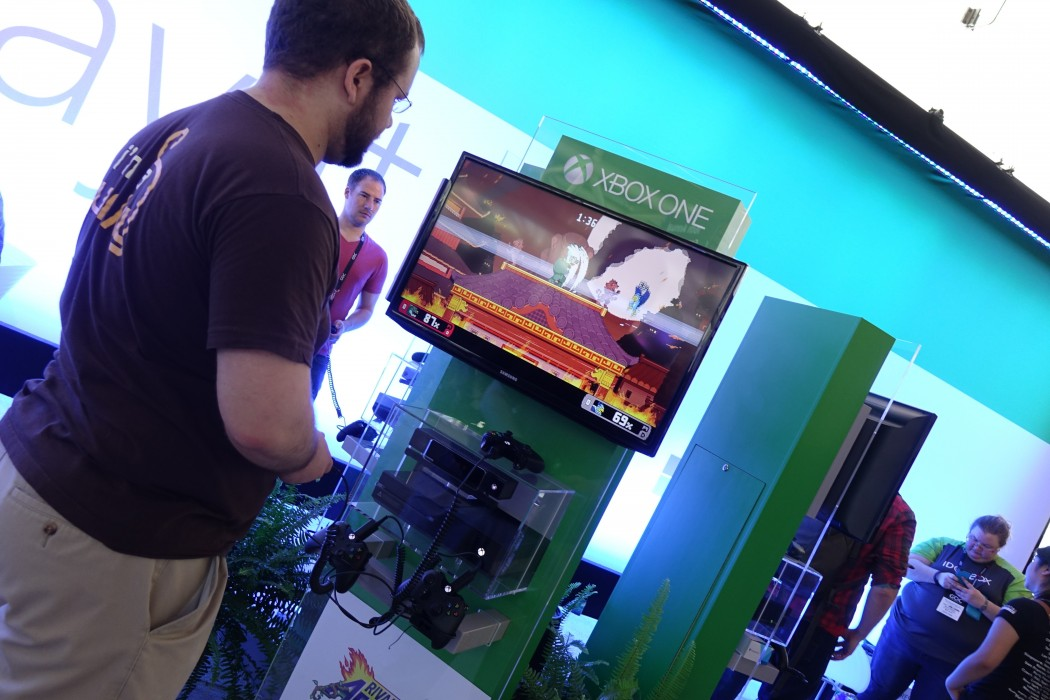 An attendee enjoys some time at the XBOX Gamer Lounge