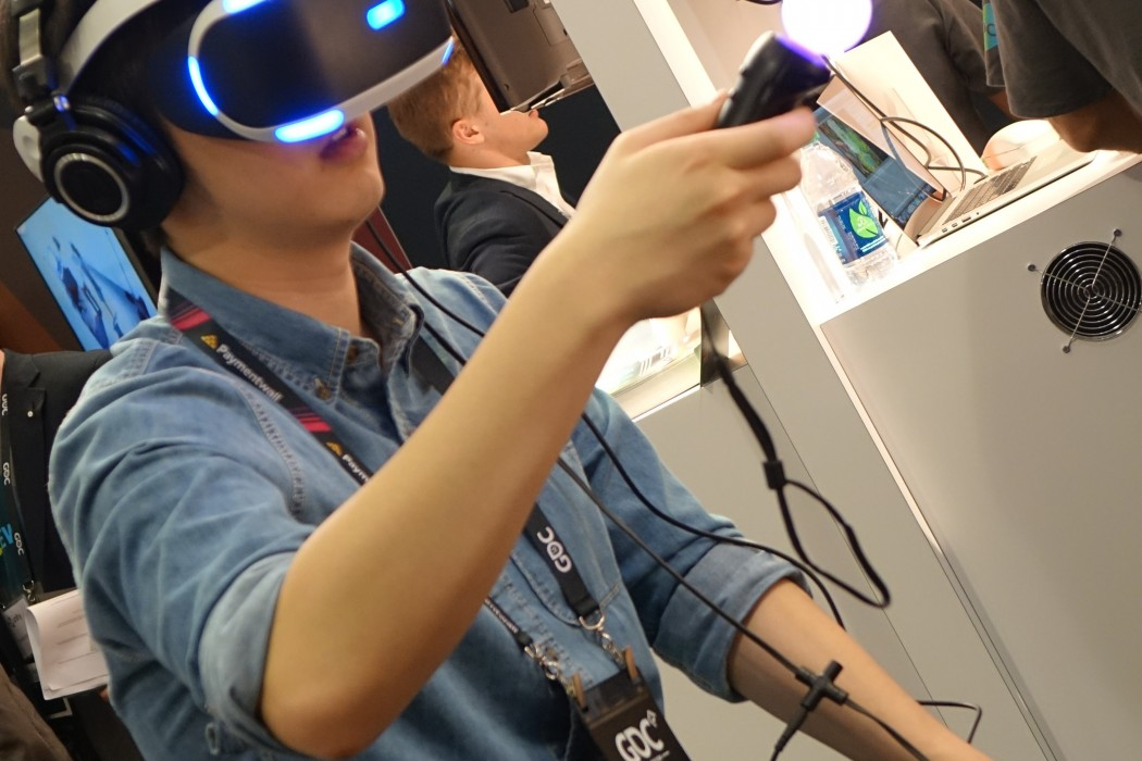 An attendee tries out Sony Playstation VR on the PS4