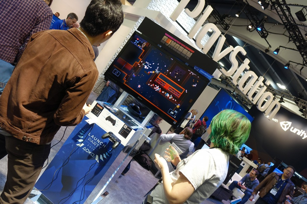 Gamers check out the Launch Party area at the Sony Playstation Booth Area at GDC